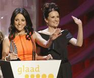 """<p>Actresses Julia Louis Dreyfus (L) and Megan Mullally accept the award for Outstanding Comedy Series for """"The New Adventures of the Old Christine"""" at the 20th GLAAD Media Awards in Los Angeles, California April 18, 2009. REUTERS/Fred Prouser</p>"""
