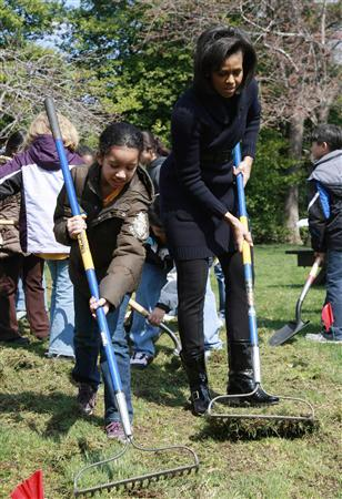U.S. first lady Michelle Obama joins 5th grade students from the Bancroft Elementary School during a groundbreaking ceremony for the new White House Kitchen Garden in Washington, in this March 20, 2009 file photo. REUTERS/Jason Reed/Files