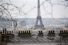 <p>The Eiffel tower is seen behind roofs from the Sacre Coeur Basilica in Paris in this recent photo from April 10, 2009. REUTERS/Charles Platiau</p>
