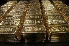 <p>Gold bars are stored on a table at a plant of gold refiner and bar manufacturer Argor-Heraeus SA in the southern Swiss town of Mendrisio November 13, 2008. REUTERS/Arnd Wiegmann</p>