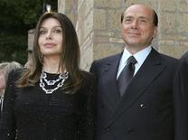 <p>Italy's Prime Minister Silvio Berlusconi and his wife Veronica Lario (L) pose at Villa Madama in Rome in a June 4, 2004 file photo. REUTERS/Alessandro Bianchi/Files</p>