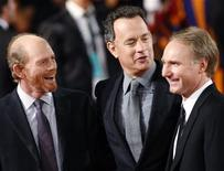"""<p>Director Ron Howard (L) and actor Tom Hanks (C) joke with author Dan Brown at the world premiere of the movie """"Angels & Demons"""" in Rome May 4, 2009. REUTERS/Tony Gentile</p>"""