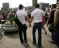 <p>Two men walk hand in hand outside the California Supreme Court during a Proposition 8 demonstration in San Francisco, California in this file photo from March 5, 2009. REUTERS/Robert Galbraith</p>
