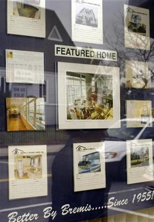 Properties for sale are displayed in the window of Bremis Realty in Somerville, Massachusetts April 2, 2009. REUTERS/Brian Snyder
