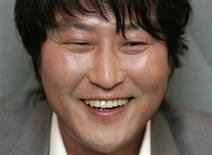 """<p>South Korean movie actor Song Kang-ho smiles during an interview with Reuters regarding his new movie """"Thirst"""", one of the 62nd Cannes Film Festival nominees, in Seoul May 4, 2009. One of South Korea's most bankable stars will return to the red carpet of the Cannes International Film Festival next week with a blood-soaked morality tale of a Catholic priest turned vampire. Picture taken May 4, 2009. REUTERS/Jo Yong-Hak</p>"""