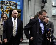 <p>Actor Kiefer Sutherland (R) departs the New York Police Department's 1st precinct in New York May 7, 2009. REUTERS/Eric Thayer</p>