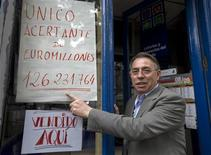 "<p>Agustin Marcos, an employee of the Black Cat lottery kiosk in central Madrid, points to a sign reading ""Sole Winner of Euro Millions 126.231.764"" in Madrid, May 9, 2009. A lottery player in Spain has won 126 million euros ($169 million), the biggest ever European jackpot for a single ticket, lottery organiser EuroMillions said on Saturday. The winner of the Friday night draw conquered odds of 76 million to one to snare the windfall which ballooned after the jackpot was not won in the previous six weekly draws. The winning numbers were 4, 29, 23, 31, 24 and the Lucky Stars 9 and 8. The total jackpot was 126,231,764 euros. REUTERS/Paul Hanna</p>"