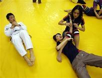 <p>Miss Universe Japan 2009 finalists take part in a Brazilian martial arts Jiu-Jitsu class in Tokyo in this picture taken April 2, 2009. REUTERS/Kim Kyung-Hoon</p>