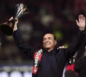 <p>Il presidente del Consiglio Silvio Berlusconi in una immagine del gennaio 2008 a San Siro. REUTERS/Daniele La Monaca (ITALY)</p>