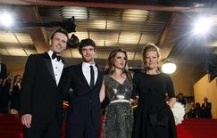 "<p>Director Andrea Arnold (R) poses with cast members (L to R) Michael Fassbender, Harry Treadaway and Kierston Wareing as they arrive for the screening of the film ""Fish Tank"" at the 62nd Cannes Film Festival May 14, 2009. REUTERS/Regis Duvignau</p>"