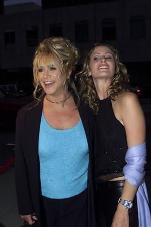 In this file photo Adult film star Marilyn Chambers (L) and actress Tracy Hutson, who portrays Chambers in the movie ''Rated X,'' pose at the film's premiere at the Academy of Motion Picture Arts and Sciences, in Beverly Hills April 27, 2000. REUTERS/Str Old
