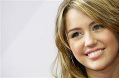 """<p>Foto de arquivo da atriz Miley Cyrus chegando na estreia de seu filme """"Hannah Montana"""" em Munique. 25/04/2009. REUTERS/Michaela Rehle</p>"""