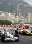 <p>BMW Sauber Formula One driver Nick Heidfeld (L) of Germany and Renault Formula One driver Nelson Piquet of Brazil drive their cars during a training session for the Monaco F1 Grand Prix in Monte Carlo, May 24, 2008. REUTERS/Robert Pratta/Files</p>