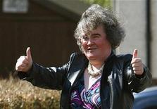"""<p>""""Britain's Got Talent"""" contestant Susan Boyle gestures to onlookers in Blackburn in West Lothian, Scotland April 21, 2009. REUTERS/David Moir</p>"""