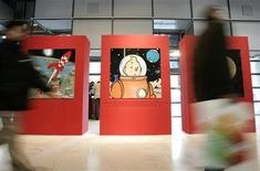 <p>Visitors pass by original drawings of Tintin during an exhibition at the Centre Pompidou modern art museum in Paris December 19, 2006. REUTERS/Benoit Tessier</p>