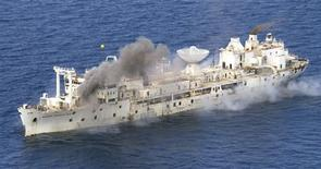 <p>The former U.S. Air Force missile-tracking ship General Hoyt S. Vandenberg begins to sink after cutting charges were detonated seven miles off Key West, Florida, May 27, 2009. The 523-foot-long Vandenberg was sunk to create an artificial reef to attract recreational divers and anglers. Some 70 percent of the $8.6 million budget was expended to rid the vessel of contaminants before it was scuttled. REUTERS/Andy Newman/Florida Keys News Bureau/Handout</p>