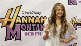 <p>U.S. actress Miley Cyrus gestures while arriving for the German film premiere 'Hannah Montana-The Movie' in Munich April 25, 2009. REUTERS/Michaela Rehle</p>