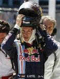 <p>Il pilota tedesco della Red Bull Sebastian Vettel alle qualificazioni del Gp di Istanbul, 6 giugno 2009. REUTERS/Pascal Lauener</p>