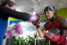 <p>A woman sparring at Crunch fitness center in New York City, 2008. REUTERS/Crunch/Handout</p>