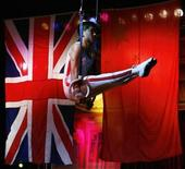 <p>A gymnast from The Chinese State Circus is seen balancing on rings during a photocall for the Edinburgh Fringe Festival shows, Scotland August 6, 2008. REUTERS/David Moir</p>
