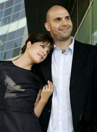 Actress Selma Blair and her husband, actor Ahmet Zappa, arrive as guests at the premiere of the romantic comedy film ''Must Love Dogs'' in Hollywood July 21, 2005. REUTERS/Fred Prouser