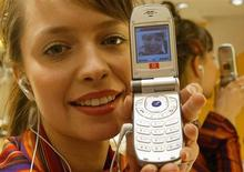 <p>La presentazione di un nuovo telefonino. REUTERS</p>