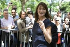 <p>France's first lady Carla Bruni-Sarkozy arrives with President Nicolas Sarkozy (hidden) at a Paris polling station to cast their votes in the European parliament election on June 7, 2009. REUTERS/Jacky Naegelen</p>