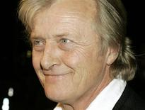 """<p>Rutger Hauer, one of the stars of the film """"Sin City"""" poses at the film's premiere in Los Angeles March 28, 2005. REUTERS/Fred Prouser</p>"""