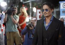 "<p>Cast member Johnny Depp poses at the premiere of the movie ""Public Enemies"" at the Mann Village theatre in Westwood, California June 23, 2009. The movie opens in the U.S. July 1. REUTERS/Mario Anzuoni</p>"