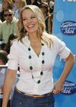 <p>Actress Jeri Ryan poses as she arrives at the finale of the American Idol television show in Los Angeles, California May 21, 2008. REUTERS/Fred Prouser</p>