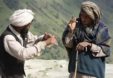 <p>Rahman Ali (L) and Khak Hussain, both deaf and mute villagers, use sign language to communicate with each other at Dadhkai Village in the Doda district, 260 km (162 miles) north of Jammu, June 18, 2009. REUTERS/Mukesh Gupta</p>