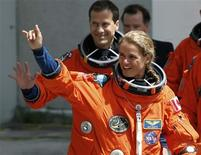 <p>Canadian Space Agency astronaut Julie Payette (R) waves as she departs with other crew members including Thomas Marshburn (L) for launch pad 39A at the Kennedy Space Center in Cape Canaveral, Florida, July 12, 2009. REUTERS/Pierre Ducharme</p>