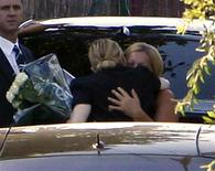 <p>US pop star Madonna hugs a family member of a technician who was killed when her concert stage collapsed, in Aix en Provence next to Marseille, July 19, 2009. REUTERS/Philippe Laurenson</p>