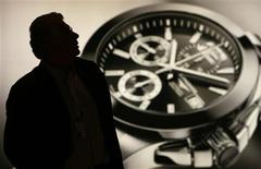 <p>A man visits the Swatch Group showcase during press day at Baselworld in Basel in this April 2, 2008 file photo. REUTERS/Christian Hartmann/Files</p>
