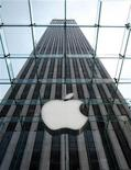 <p>The Apple logo hangs from the entrance new Apple retail store on Fifth Avenue, with the GM building in the background, in New York, May 18, 2006. REUTERS/Brendan McDermid</p>
