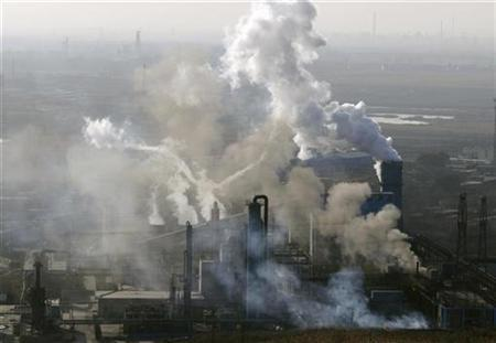 Smoke billows from the chimneys at a coking factory in Changzhi, Shanxi province November 13, 2008. REUTERS/Stringer