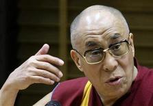<p>Tibetan spiritual leader the Dalai Lama gives a lecture at the University of Warsaw July 28, 2009. REUTERS/Peter Andrews</p>