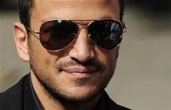 <p>Singer Peter Andre arrives at The High Court in central London July 31, 2009. Andre had claimed a newspaper article about him was untrue, local media reported. REUTERS/Toby Melville</p>