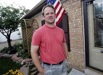 <p>Former autoworker Matthew Derra, 41, stands in front of his house in Chesterfield Township, Michigan July 28, 2009. Derra, who lost his job with struggling auto supplier American Axle & Manufacturing Holding Inc in July 2008, is now earning an associate degree in renewable energy and wants to find a job manufacturing wind turbines. REUTERS/Rebecca Cook</p>