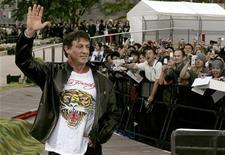 """<p>Sylvester Stallone waves to fans during the premiere for his latest movie """"Rambo"""" in Tokyo May 8, 2008. REUTERS/Toru Hanai</p>"""