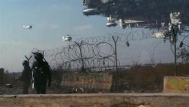 <p>A scene from TriStar Pictures' sci-fi thriller DISTRICT 9. REUTERS/Courtesy of TriStar Pictures/Handout</p>