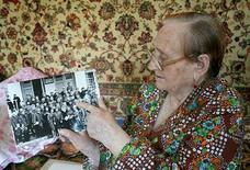 """<p>Yelena Zyuzka, 85, shows an archive photo in her apartment in Magadan, July 20, 2009. Seventy years of Soviet rule failed to subdue Russia's most isolated natives, but """"perestroika"""" proved to be devastating. In the ensuing lawlessness, poachers decimated reindeer herds and unemployment was rife. REUTERS/Robin Paxton</p>"""