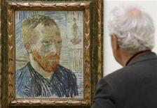 <p>A man looks at the painting 'Self Portrait with a Japanese print' from 1887 by late Dutch artist Vincent van Gogh (1853-90) during a media preview at the Kunstmuseum Basel in Basel April 23, 2009. REUTERS/Arnd Wiegmann</p>