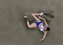 <p>A saltadora brasileira Maurren Maggi durante salto que a classificou para a final no Mundial de Atletismo, em Berlim, na sexta-feira. REUTERS/Pawel Kopczynski</p>