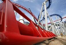 <p>A construction worker walks past part of a roller coaster track which will be hoisted into place at Resorts World Sentosa in Singapore June 25, 2009. REUTERS/Vivek Prakash</p>