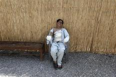 <p>Asmit Ali, 14, sits outside his ward where he is being treated at a field hospital by the International Committee for the Red Cross (ICRC) in Peshaswar August 28, 2009. REUTERS/Faisal Mahmood</p>