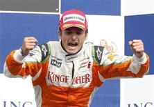 """<p>Джанкарло Физикелла из """"Форс Индии"""" радуется второму месту в Бельгийском Гран-при """"Формулы-1"""" 30 августа 2009 года. Новым пилотом команды """"Феррари"""" автогонок класса """"Формула 1"""" станет Джанкарло Физикелла из """"Форс Индии"""", сообщила индийская команда в четверг. REUTERS/Yves Herman</p>"""