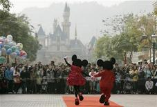 <p>Mickey Mouse and Minnie Mouse greet visitors with their latest Year of the Mouse costumes at Hong Kong Disneyland, 21, 2008. REUTERS/Bobby Yip</p>