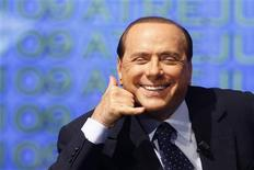 <p>Italian Prime Minister Silvio Berlusconi gestures during a right-wing youth party meeting in Rome September 9, 2009. REUTERS/Remo Casilli</p>