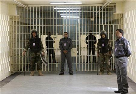 Prison guards secure the main gate of the newly named Baghdad Central Prison in Baghdad's Abu Ghraib February 21, 2009. REUTERS/Mohammed Ameen